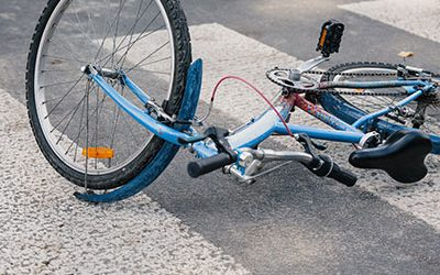 Car Cuts off Bicycle; Crash Herniates Bicyclist's Spinal Disc