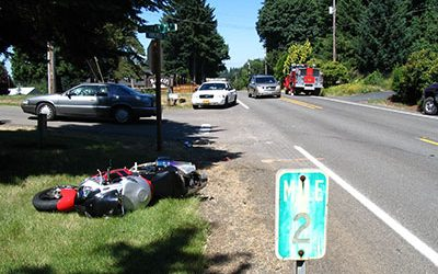 Car Turns Directly In Front of Motorcycle, Causing Crash