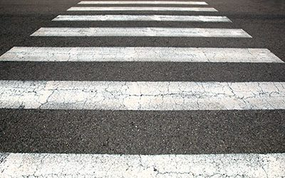 Jogger Injured in Crosswalk: Knee Injury